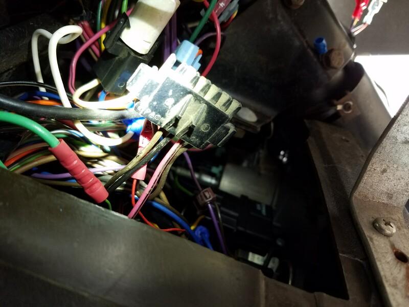 Unpluged wire connector under dash