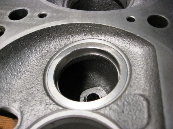 J head exhaust valve insert