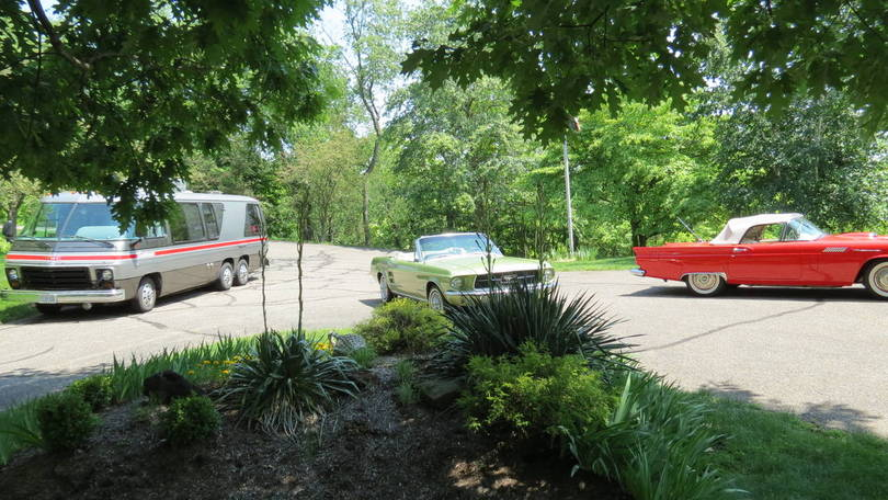 GMC and old cars on my driveway