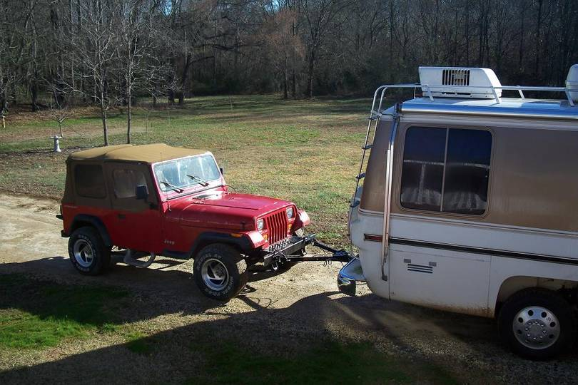 GMC towing jeep
