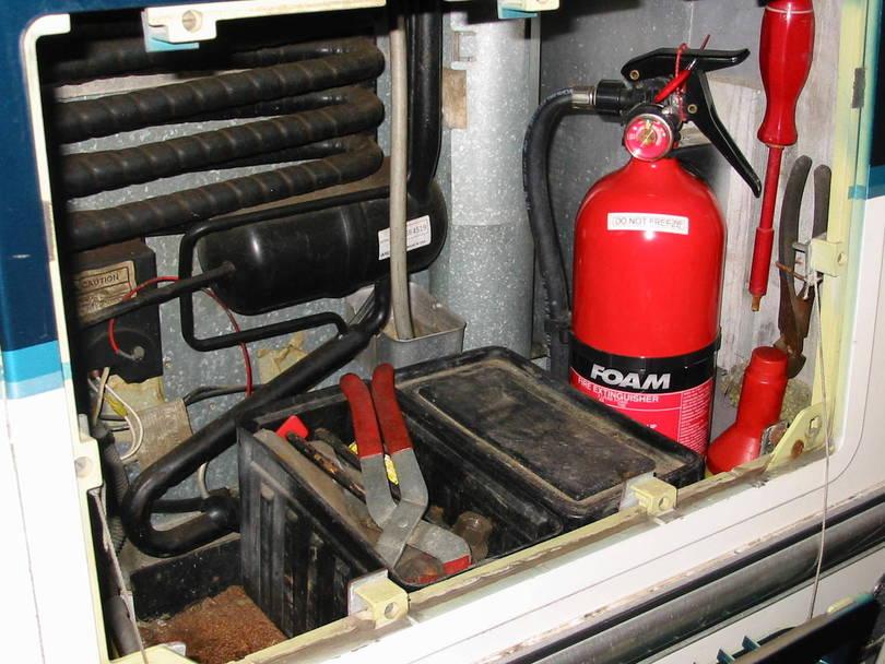 storage fire extingusher not affecting air flow for refer. Black Bedroom Furniture Sets. Home Design Ideas